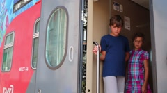 Two children (models with releases) in two-storey train arrives. - stock footage
