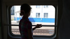 Back of girl looking at window in moving modern train. Stock Footage
