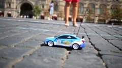 Stock Video Footage of Radio controlled toy car Chevrolet move on Red square.