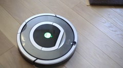 Round electronic iRobot cleaner on floor. Stock Footage