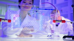 Asian female scientist using touchscreen technology for analysis in laboratory - stock footage