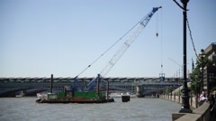 Crane at work on Thames River, London, England, Europe Stock Footage