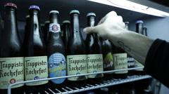 arranging beer bottles - stock footage