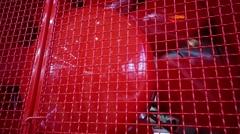 Big red metal shiny vertiginous propeller in red grid Stock Footage