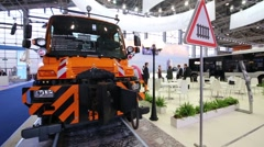 Truck Unimog U400 (Mercedes Benz) at exhibition city transport Stock Footage