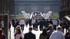 Crowd in London on Millennium Bridge, London, England, Europe - stock footage
