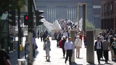 Crowds crossing Millennium Bridge, London, England Stock Footage