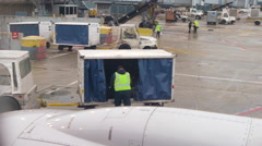 Moving luggage carts around the airport Stock Footage