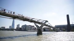 Millennium Bridge from the bank, London, England - stock footage