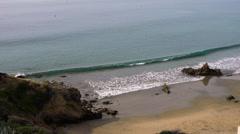 Gentle waves splash on the rocks Stock Footage