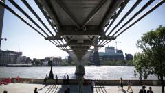 Millenium Bridge underneath tilt, London, England Stock Footage