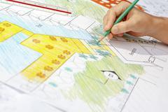 Stock Photo of Landscape architect design hotel resort plan.