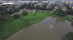 Aerial View over large pond in Park Stock Footage