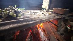 Delicious sea shell with spices grilled on fire using traditional kitchen. Stock Footage