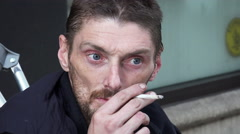 Stock Video Footage of drug addicted man asking for the charity