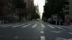 Stock Video Footage of empty quiet morning on Lower 5th Ave with Empire State Building in view 4K NYC