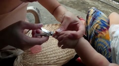 Mother nail clipping baby's fingernails - stock footage