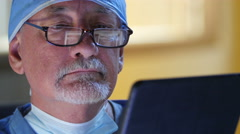 Male surgeon using ipad/tablet Stock Footage