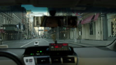 Taxi cab interior from passenger pov of windshield and front seat meter rearview Stock Footage