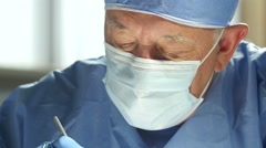 Surgeon in surgery, extreme close up Stock Footage