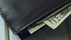4K: US Currency Sticking Out Of A Wallet Spinning Into Frame Stock Footage