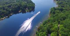 Aerial Jet Ski Summer Recreation Following Boat on Cottage Lake Vacation Area 4K - stock footage