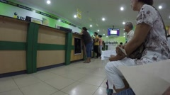 People sitting in queue in government office Stock Footage