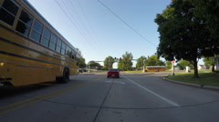 Busy intersection with school buses Arkistovideo