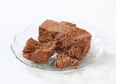 Pieces of chocolate halva on plate - stock photo
