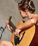 Young teenage girl with guitar Stock Photos