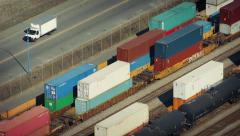 Cars Passing Railway Yard With Boxcars Stock Footage