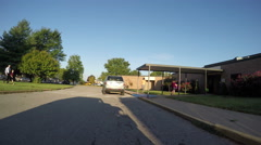 Elementary School crosswalk with students, parents and teachers arriving Stock Footage