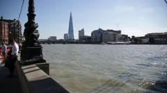 Shard and muddy Thames River, London, England Stock Footage