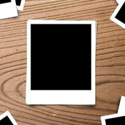 blank photo frame on brown wood old background texture - stock photo