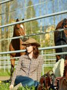 Cowgirl and horse - stock photo