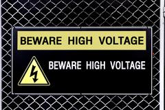 Beware high voltage sign - stock photo