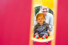 Caucasian mother and daughter playing at playground Stock Photos
