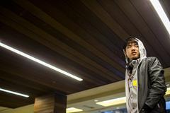 Asian man walking under wooden ceiling Stock Photos