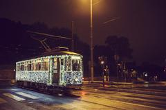 Illuminated streetcar on city street, Rome, Italy Stock Photos