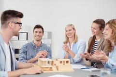 Group of Designers Clapping Hands for Colleague - stock photo