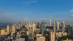 Beautiful Kuala Lumpur skyline time lapse with blue skies with pan effect Stock Footage