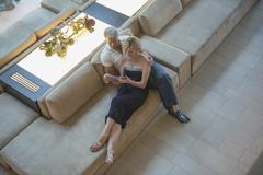High angle view of Caucasian couple using digital tablet in hotel lobby Kuvituskuvat