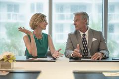 Caucasian business people talking in meeting Stock Photos