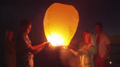 Group of Friends are Launching Sky Lantern Stock Footage