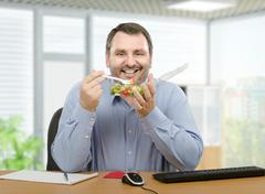 Healthy lunchtime for man at the office - stock photo