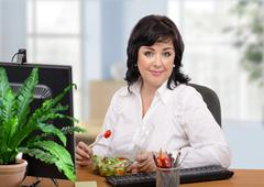 Stock Photo of Woman with takeaway green salad