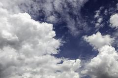Nice clouds in bright sky - stock photo