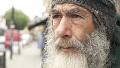 Sad old man in the city: homeless looking in the street. poor man Stock Footage
