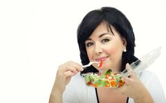 Stock Photo of Portrait of woman with green salad