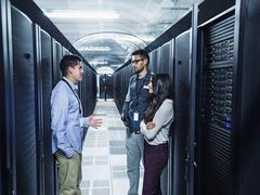Technicians talking in server room Kuvituskuvat